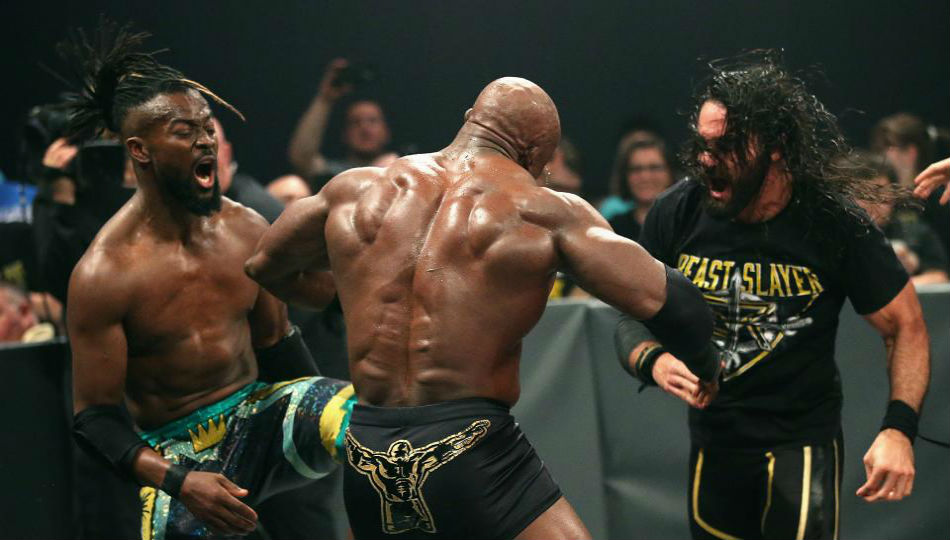Kofi Kingston and Seth Rollins attack Lashley during Raw main event (image courtesy WWE.com)