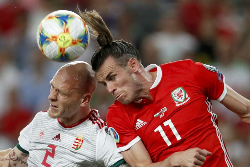 Hungarys Botond Barath (left) and Wales Gareth Bale in aerial duel