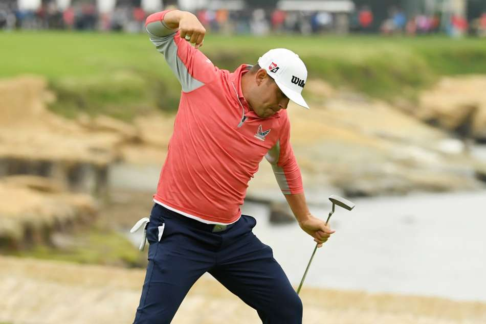Gary Woodland celebrates after claiming his first major title