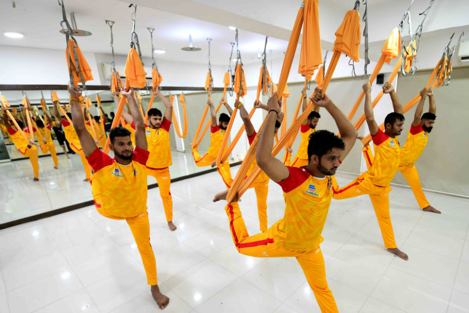 Gujarat Fortunegiant players perform Yoga