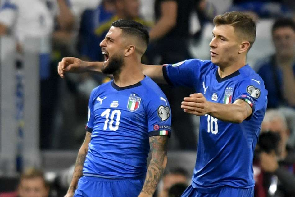 Lorenzo Insigne (left) inspired Italy to a comeback win