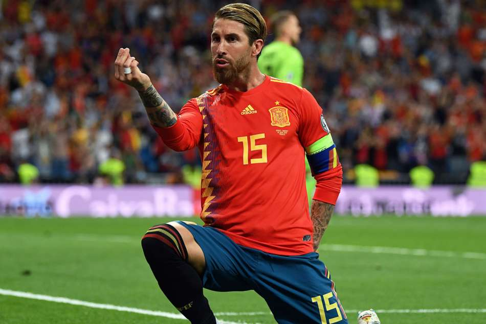 Spain captain Sergio Ramos celebrates after converting a penalty