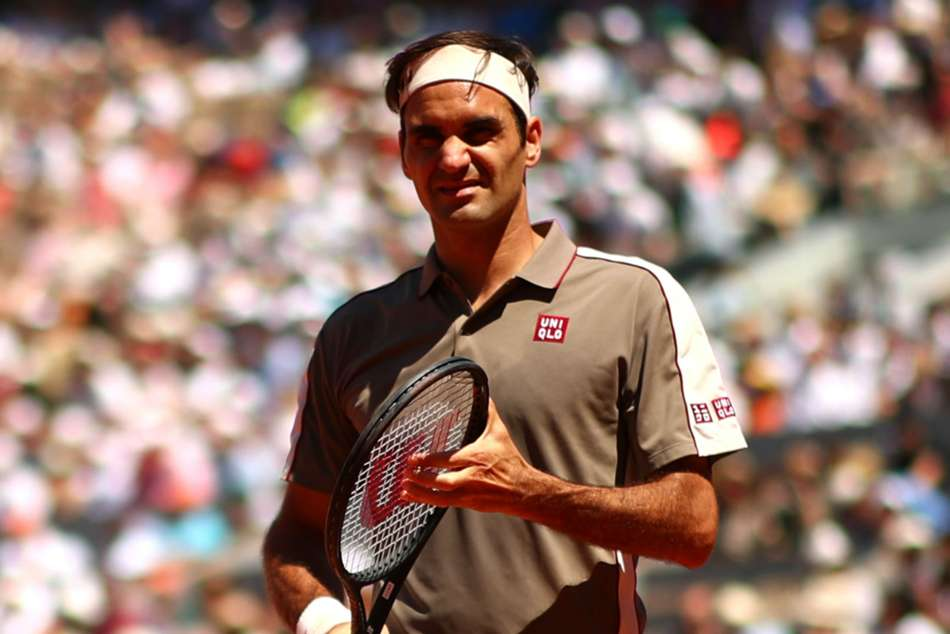 Nine-time champ Federer cruises through Halle opener