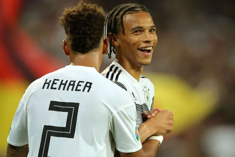 Manchester City star Leroy Sane (right) has been linked with a move to Bayern Munich