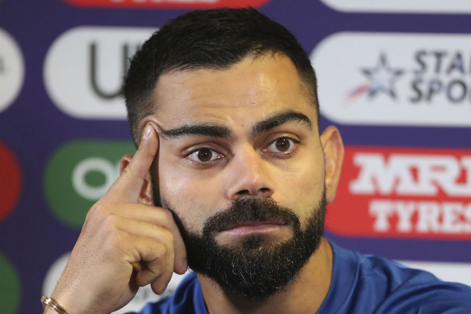 Indias captain Virat Kohli listens to a question from a journalist during a press conference