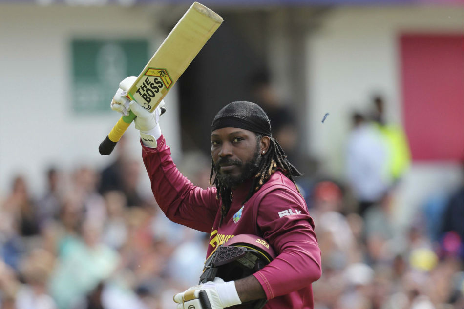 Chris Gayle salutes the crowd after he played the last match of his fifth and final World Cup against Afghanistan