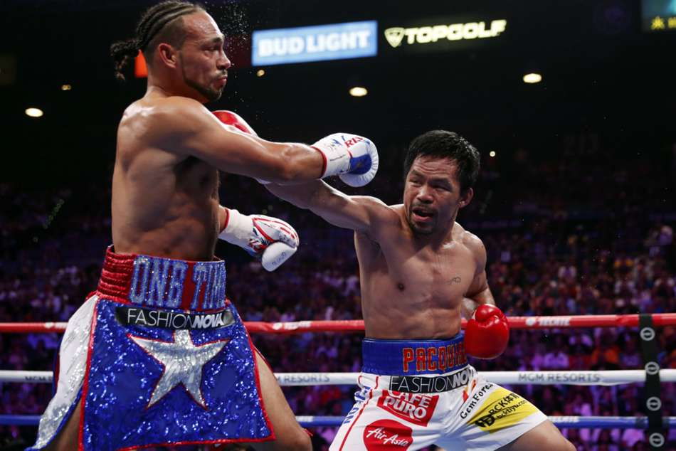 Pacquiao wins WBA welterweight title with split-decision victory over Thurman