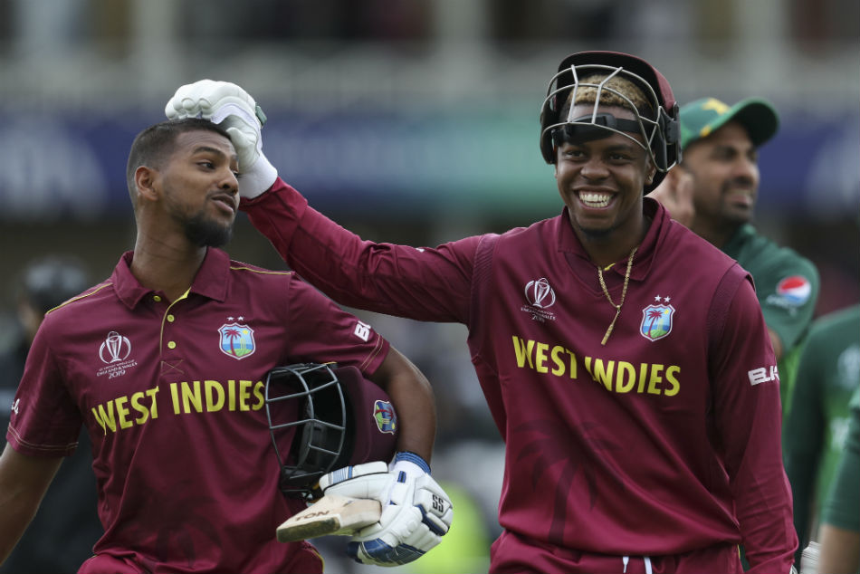 Nicholas Pooran (left) was handed a white ball contract by the West Indies