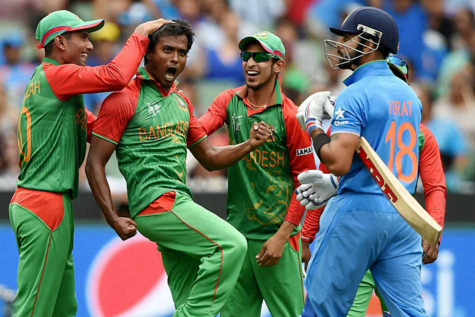 Rubel Hossain, second left, celebrates with team-mates after dismissing Virat Kohli during the 2015 World Cup quarterfinal in Melbourne.