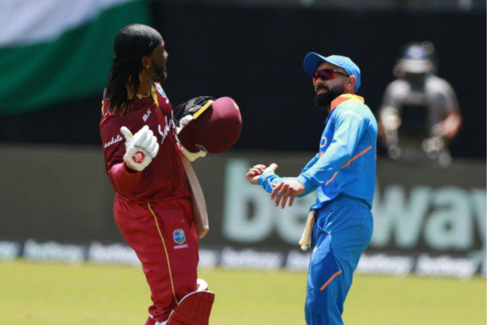 Chris Gayle and Virat Kohli during the third ODI in Port-of-Spain (Image Courtesy: Twitter)
