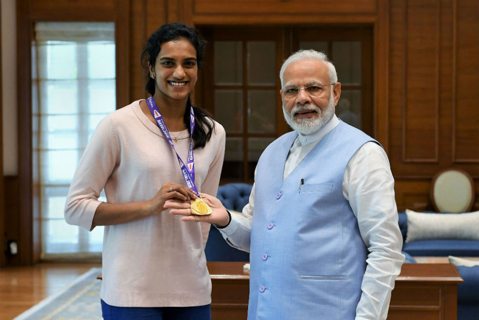 PV Sindhu meets PM Modi, Sports Minister presents Rs 10 lakh cheque to world champion