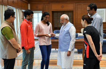 Sindhu accompanied by Sports Minister