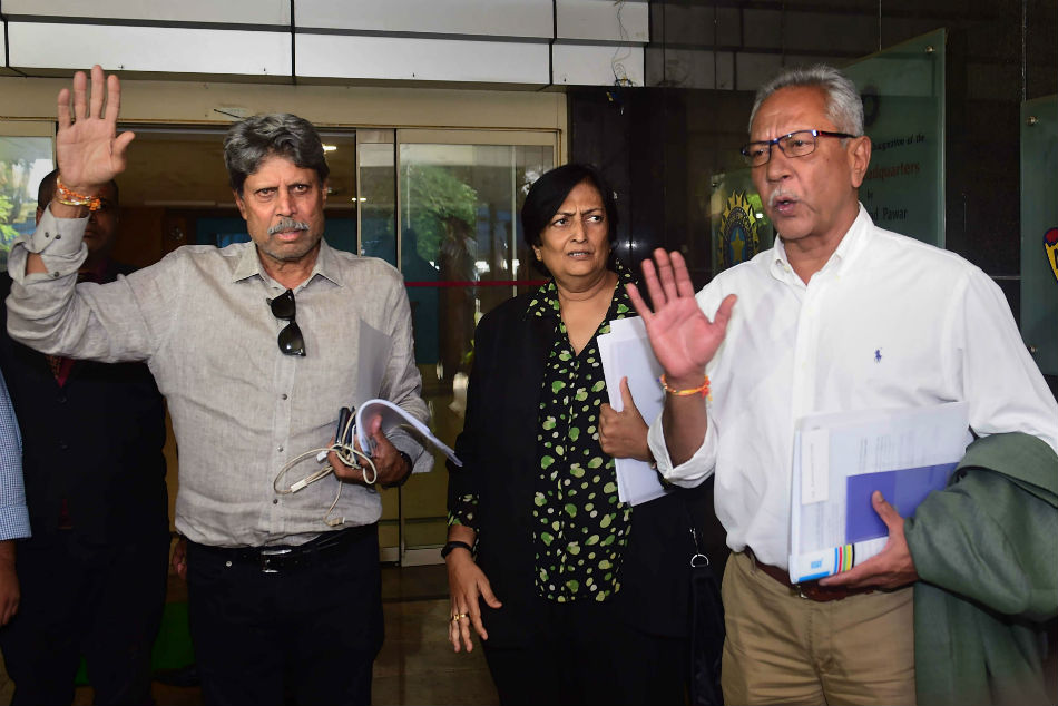 File photo: Former India captain Kapil Dev, who is the Chairman of Cricket Advisory Committee, along with Anshuman Gaekwad and Shantha Rangaswamy leave the BCCI headquarters.