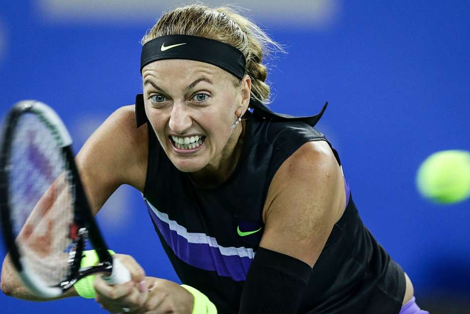 Kvitova battles through as seeds tumble in Wuhan