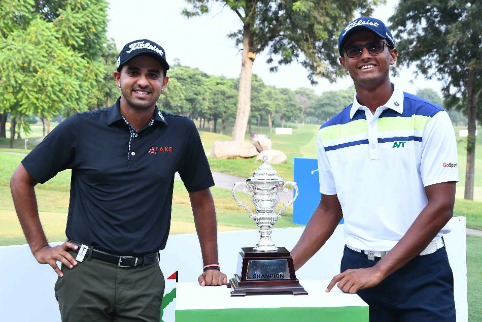 Khalin Joshi and Viraj Madappa with the trophy on the eve of the tournament