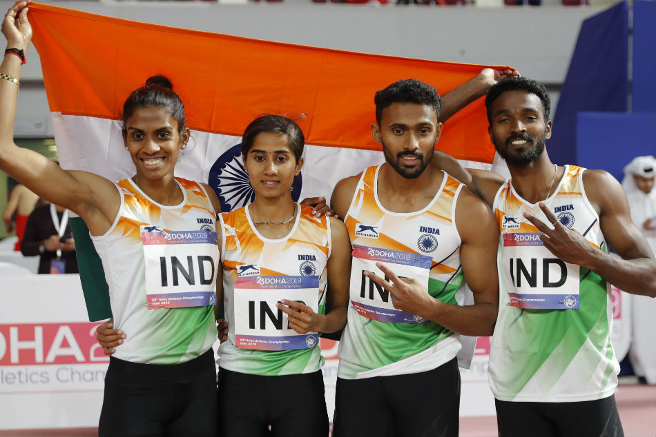 Indian athletes celebrate after competing in the 4x400 mixed relay final at the Asian Athletics Championships in Doha, Qatar