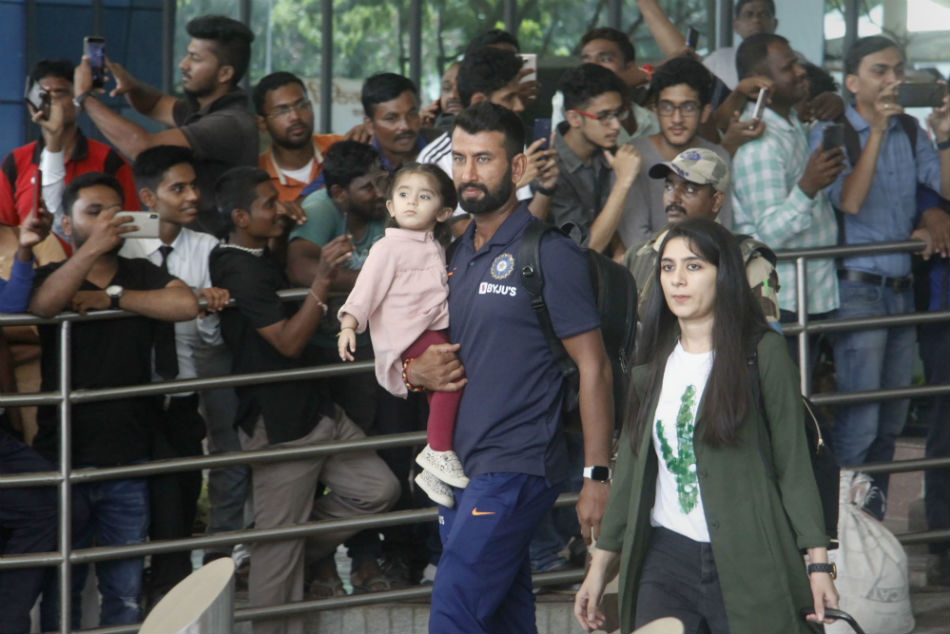 Pujara accompanied by family