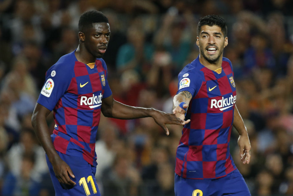 Barcelonas Luis Suarez (right) celebrates with Osumane Dembele after scoring a stunning left-footed bicycle kick