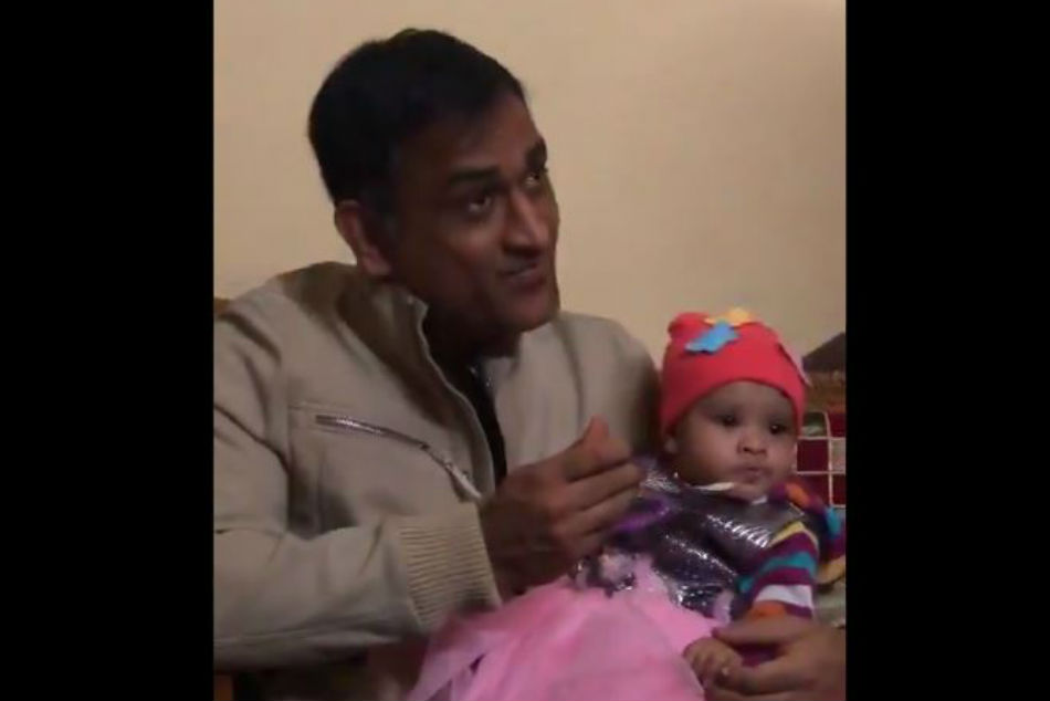 MS Dhoni feeds a girl child on her Annaprashana, video goes viral - Watch