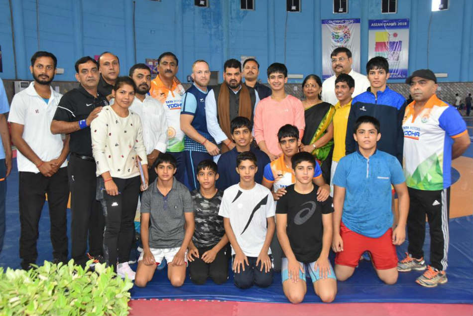 WFI President Brij Bhushan Sharan pose with the coaches and girls wrestling team