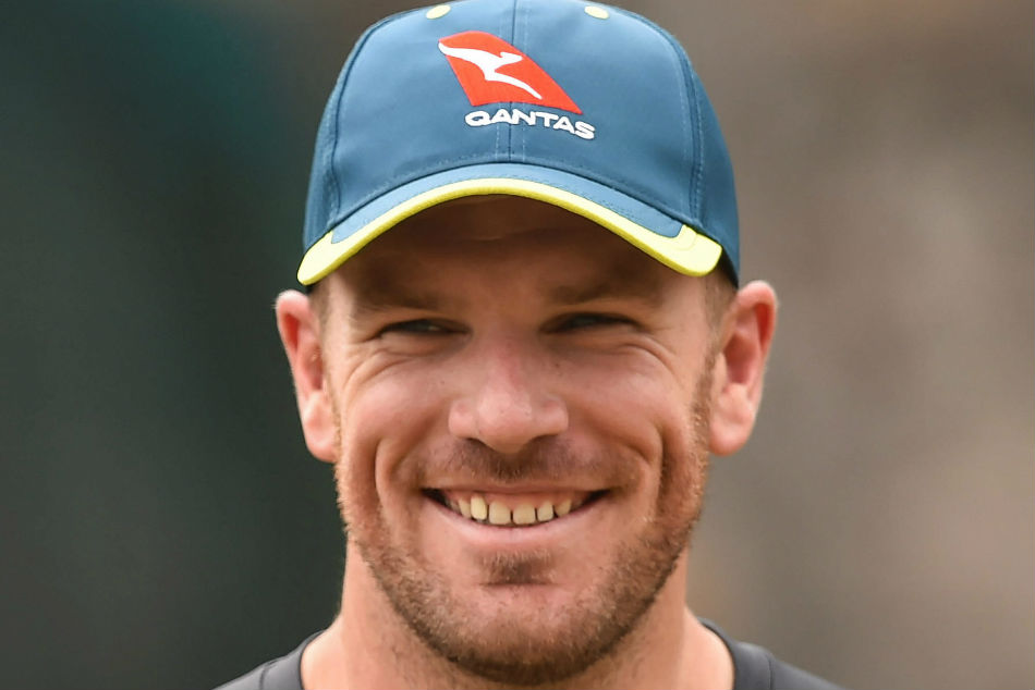 "Australia skipper Aaron Finch helps a pupil in ""remote learning"""