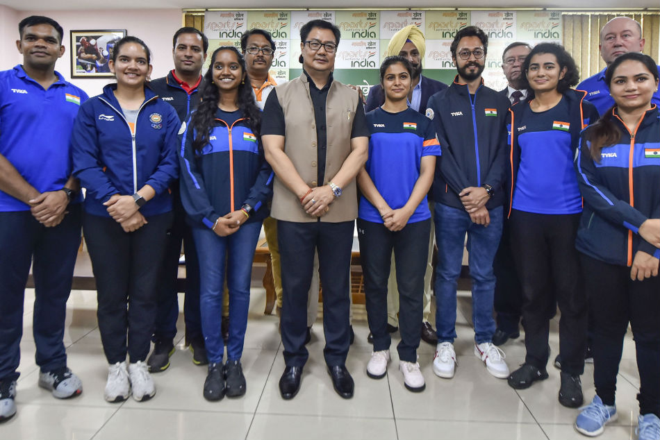 Union Sports Minister Kiren Rijiju with members of the Indian shooting team