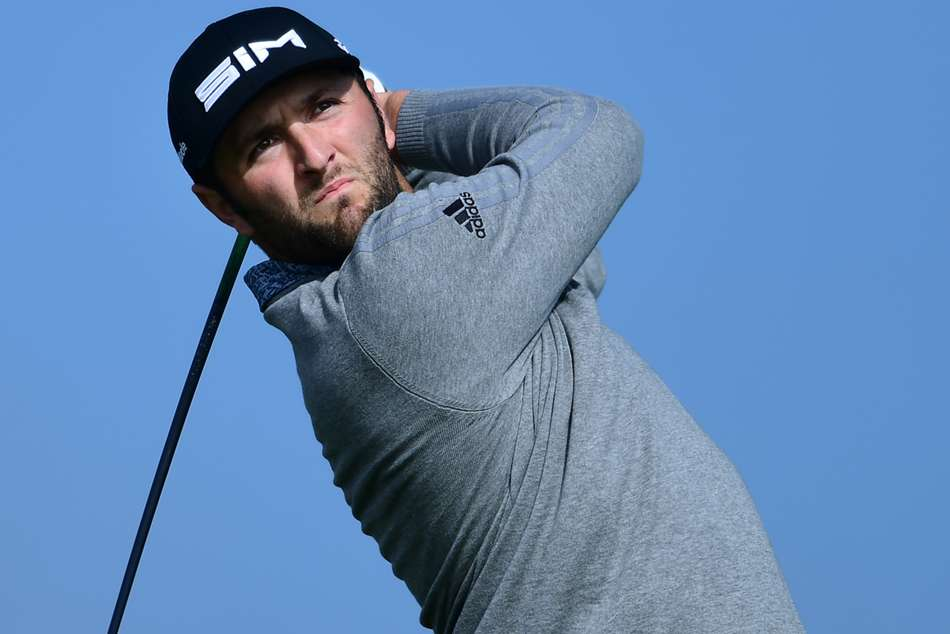 Jon Rahm holed out from 111 yards at the par-four second after a birdie