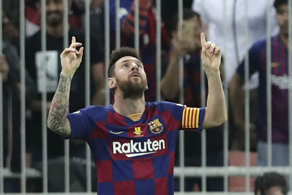 Messi takes Barcelona back to the top of La Liga