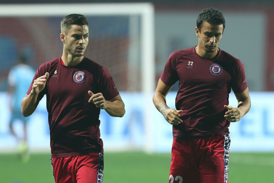 JFCs Aitor Monroy and Memo Moura train ahead of their crucial tie against Chennaiyin FC at Jawaharlal Nehru Stadium, Chennai