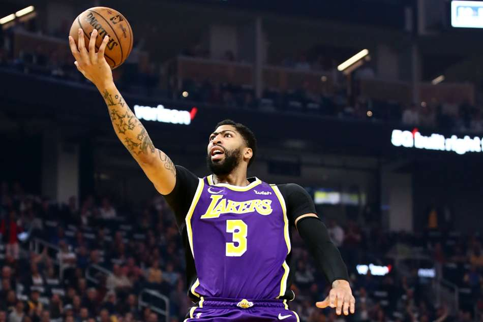 Davis leads Lakers in LeBron's absence, 76ers win without Embiid and Simmons