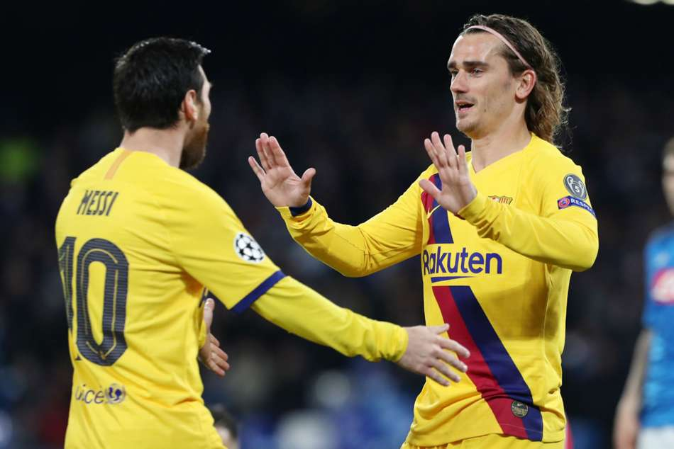 Antoine Griezmann (right) celebrates his second Champions League goal for Barcelona