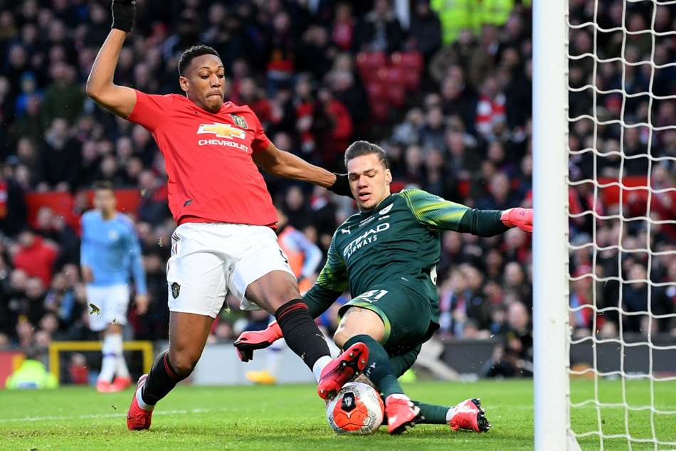 Anthony Martial shoots past Ederson