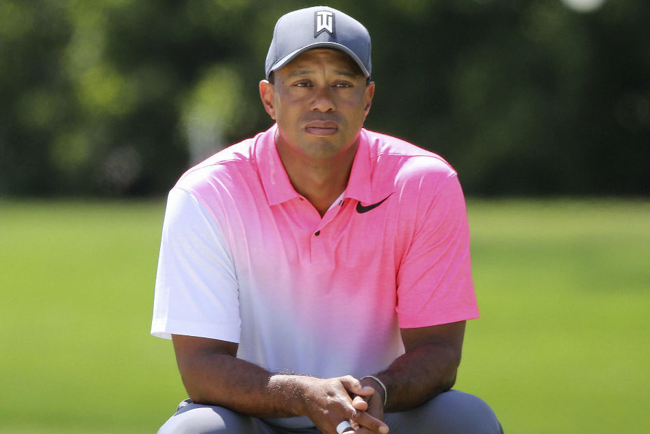 Florida man suing Woods, caddie over alleged shove