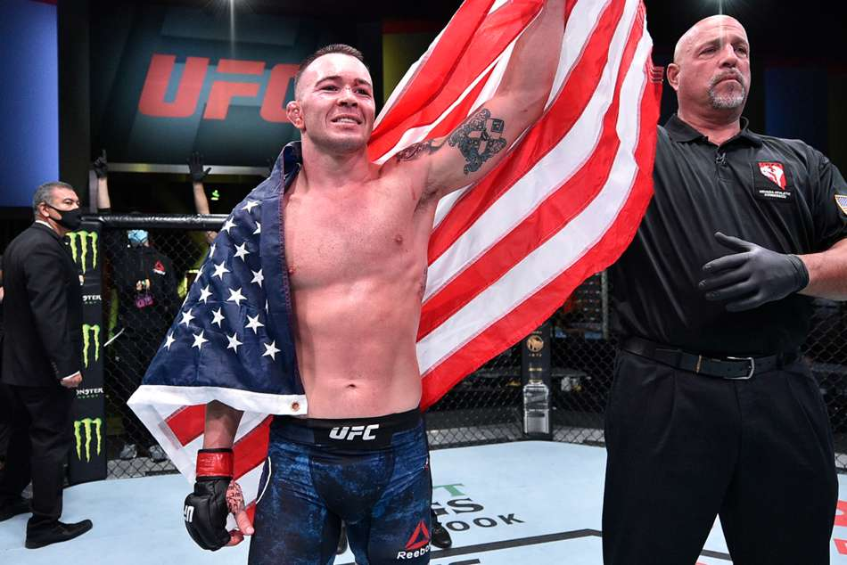 Covington takes call from Trump after TKO win over Woodley