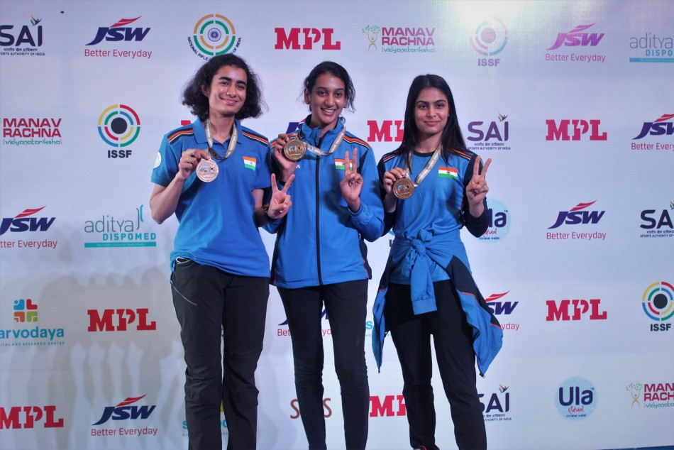 Womens 10M Air Pistol Team poses with Gold medal
