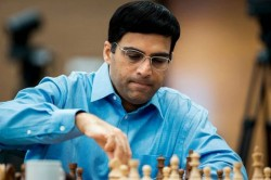 Anand Crushes Caruana Join Giri Lead