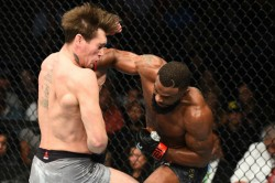 Ufc 228 Results Woodley Drops Chokes Till Retain Title