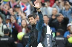 Djokovic Dazzles But Del Potro Feels The Strain Shanghai