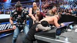 Roman Reigns The Miz Fended Off From Shane Mcmahon And Elias On Smackdown