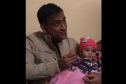 Ms Dhoni Feeds A Girl Child On Her Annaprashana Video Goes Viral