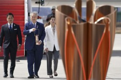 Coronavirus Arrival Of Olympics Flame In Japan Raises Tricky Questions