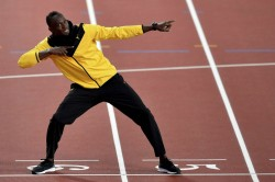 Usain Bolt Uses Iconic Image As Example For Social Distancing