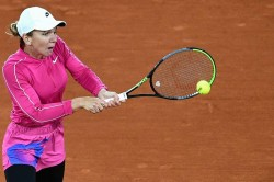 French Open Simona Halep Wins First Round Match On Her Birthday