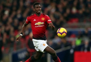 Pogba happy with United approach