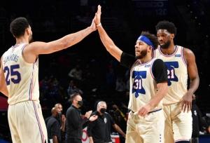 76ers top Nets in East showdown