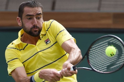 Cilic bows out as Del Potro wins