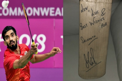 Dhoni gifts signed bat to Srikanth