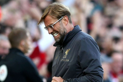 Liverpool maintain perfect start