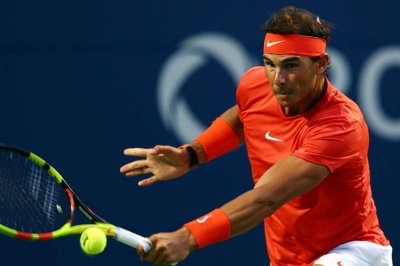 Nadal into QFs with Wawrinka win