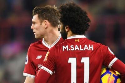 Milner congratulates Salah